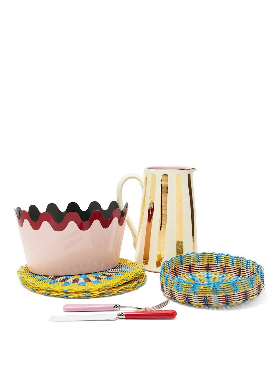 """<p>Create the perfect ambience for a stylish lunch in the sun with Matilda Goad's vibrant homeware. Featuring her signature scallop-edging and whimsical colour combinations, woven placemats and a matching basket, candy-hued cutlery and chic gilded water jugs, they are a wonderful accompaniment to a sunny day. Brooke Theis</p><p>From £8 at <a href=""""https://matildagoad.com/collections/tabletop"""" rel=""""nofollow noopener"""" target=""""_blank"""" data-ylk=""""slk:Matilda Goad"""" class=""""link rapid-noclick-resp"""">Matilda Goad</a>.</p>"""