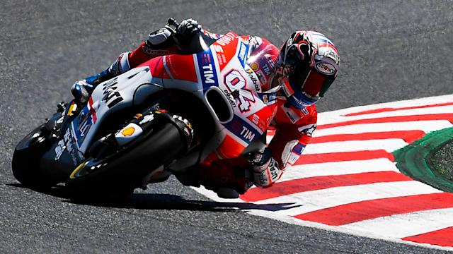 MotoGP title rivals Andrea Dovizioso and Marc Marquez look set to do battle in Japan after a wet opening day at Motegi.