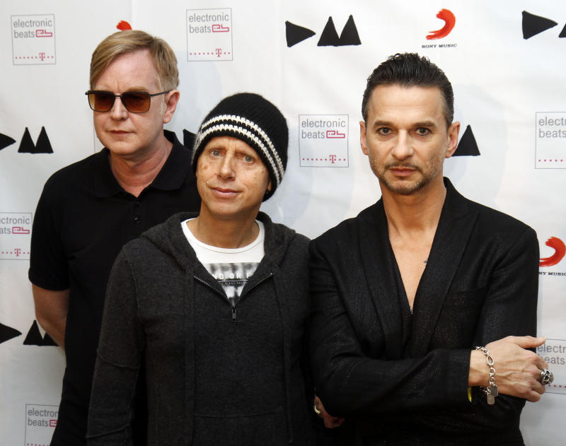 """FILE - This March 24, 2013 file photo shows, from left, Andrew Fletcher, Martin Gore and Dave Gahan, from Depeche Mode at the  Depeche Mode Delta Machine Album launch in Vienna, Austria. Depeche Mode's dark, electronic grooves are all over """"Delta Machine,"""" the trio's 13th release, out this week. (AP Photo/Ronald Zak, file)"""