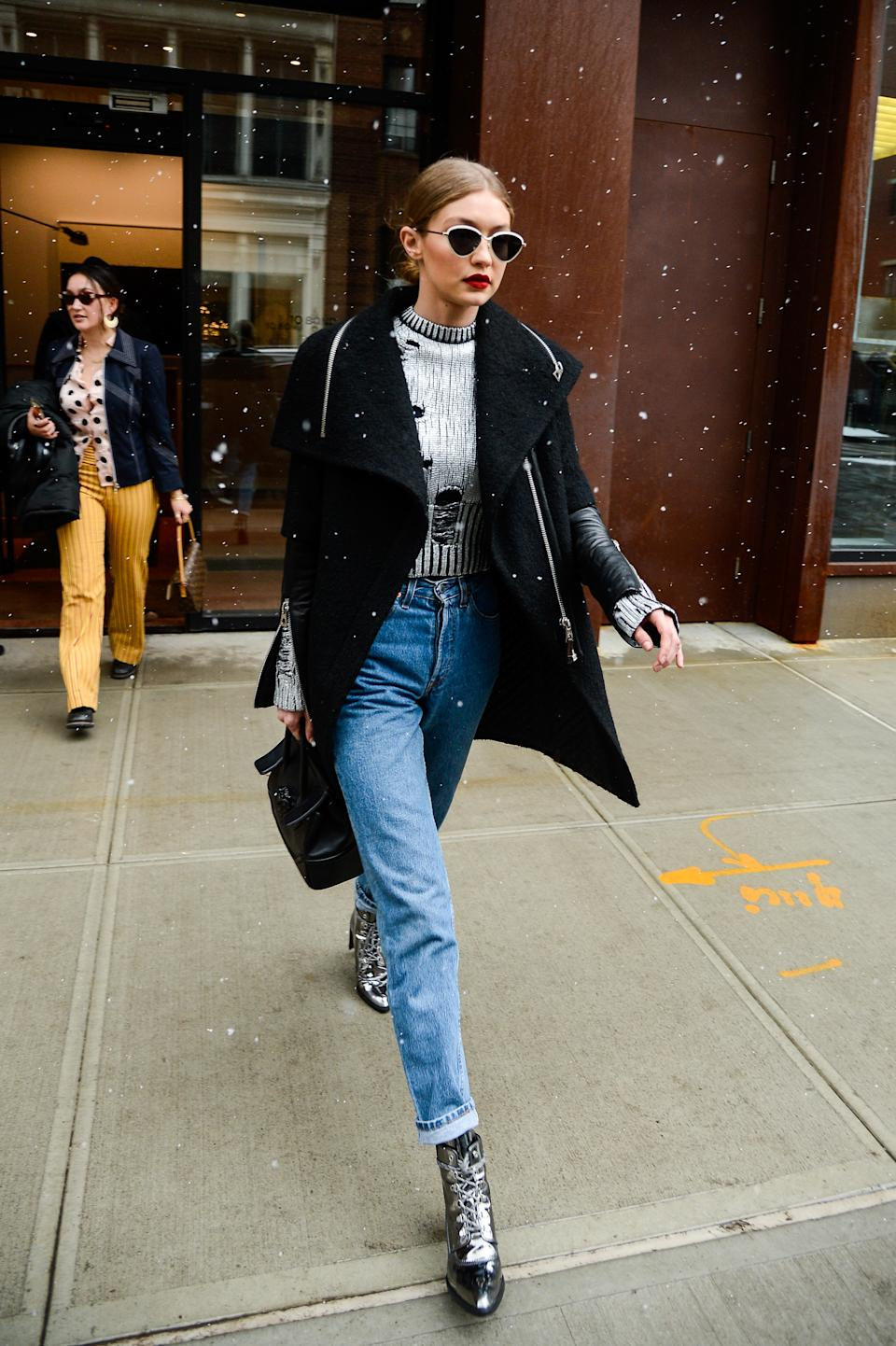 Gigi Hadid out in New York wearing lace-up pointy boots. [Photo: Getty]