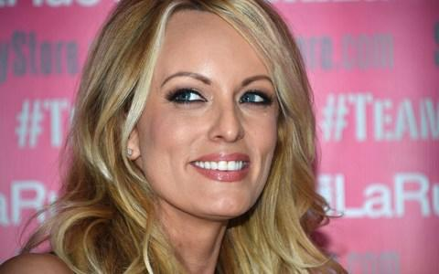 """(FILES) In this file photo taken on May 23, 2018 adult film star Stormy Daniels poses and signs autographs at Chi Chi Larue's adult entertainment store in West Hollywood, California. - Stormy Daniels, the porn star who claims to have slept with Donald Trump over a decade ago, says in her upcoming tell-all book that it may have been the """"least impressive sex"""" she'd ever had, The Guardian reported on September 18, 2018. In her book, """"Full Disclosure,"""" Daniels also provides a graphic description of Trump's genitalia, including a reference to a toadstool-shaped character on the Mario Kart videogame, the British newspaper said. (Photo by Robyn Beck / AFP)ROBYN BECK/AFP/Getty Images - Credit: ROBYN BECK/AFP"""