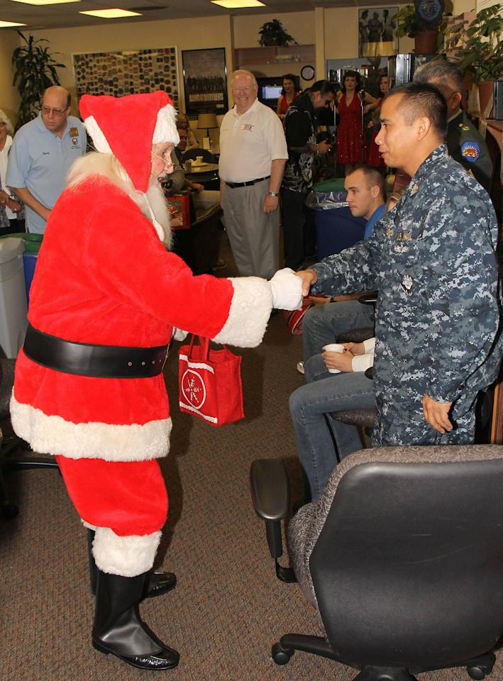 Santa Claus meets the troops,  at the United Service Organizations Inc. (USO) 'Christmas Dinner to Troops' at LAX and raised  $10,000 to the organisation. Los Angeles, California - 21.12.11 Mandatory Credit: WENN.com
