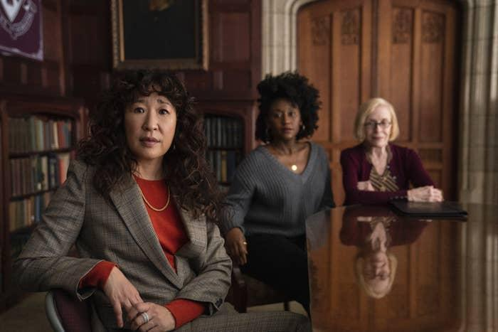 Sandra Oh, Nana Mensah, and Holland Taylor sitting at a table in The Chair