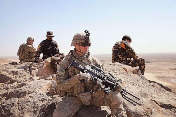 PHOTO: SPC Richard Reilly of Chicago, Illinois and other soldiers with the U.S. Army's 4th squadron 2d Cavalry Regiment patrol with police from Afghanistan's National Defense Service, Feb. 28, 2014 near Kandahar, Afghanistan. (Scott Olson/Getty Images)