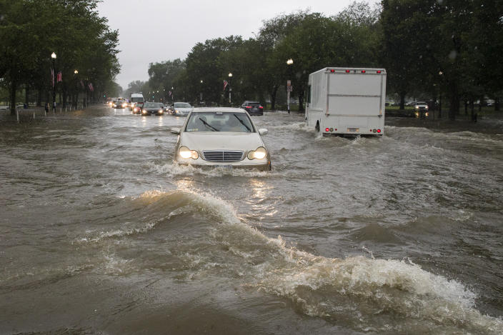 Heavy rainfall flooded the intersection of 15th Street and Constitution Ave., NW, stalling cars in the street, Monday, July 8, 2019, in Washington. (Photo: Alex Brandon/AP)