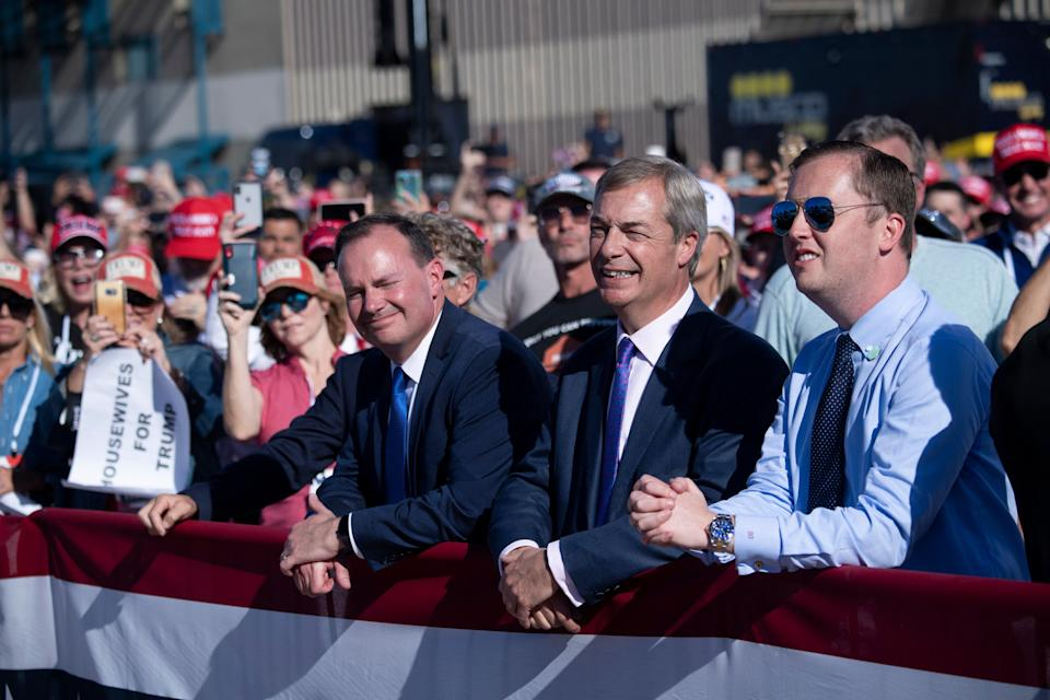 Senator Mike Lee (R-UT), Nigel Farage, and others wait for US President Donald Trump to speak during a Make America Great Again rally at Phoenix Goodyear Airport October 28, 2020, in Goodyear, Arizona. (Photo by Brendan Smialowski / AFP) (Photo by BRENDAN SMIALOWSKI/AFP via Getty Images)