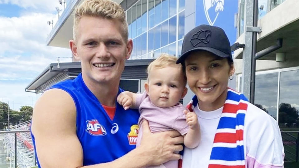 Adam Treloar, pictured here with his wife and baby at Whitten Oval.