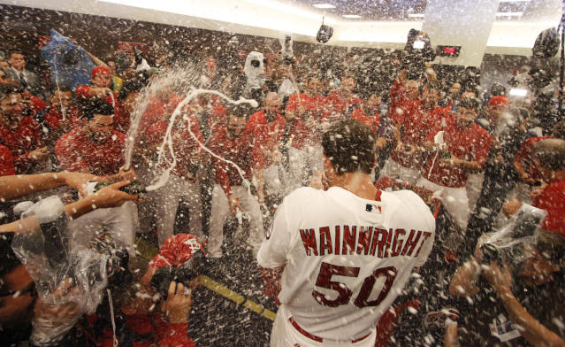 Teammates spray St. Louis Cardinals starting pitcher Adam Wainwright with champagne in the clubhouse after Game 5 of the National League Division Series between the St. Louis Cardinals and the Pittsburgh Pirates on Wednesday, Oct. 9, 2013, at Busch Stadium in St. Louis. Photo by Chris Lee, clee@post-dispatch.com