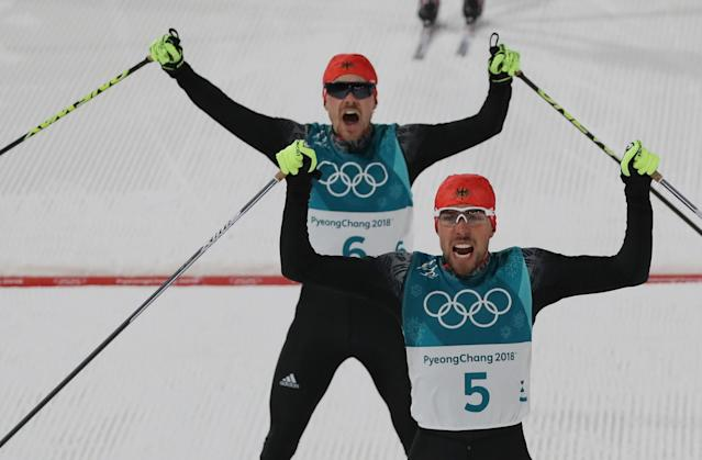 Nordic Combined Events - Pyeongchang 2018 Winter Olympics - Men's Individual 10 km Final - Alpensia Cross-Country Skiing Centre - Pyeongchang, South Korea - February 20, 2018 - Gold medalist, Johannes Rydzek of Germany and silver medalist, Fabian Riessle of Germany react as they cross the finish line. REUTERS/Carlos Barria