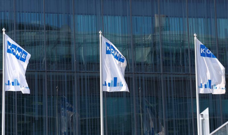 FILE PHOTO: Finnish company KONE flags flutter at their headquarters in Espoo