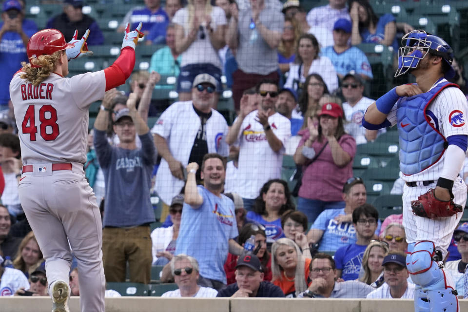 St. Louis Cardinals' Harrison Bader, left, celebrates after hitting a solo home run as Chicago Cubs catcher Willson Contreras looks up during the eighth inning of a baseball game in Chicago, Sunday, Sept. 26, 2021. (AP Photo/Nam Y. Huh)