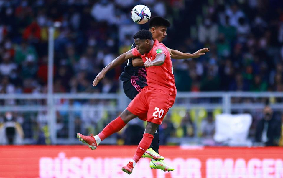 Jonathan David of Canada battles for possesion with Jesus Gallardo of Mexico during the match between Mexico and Canada as part of the Concacaf 2022 FIFA World Cup Qualifier at Azteca Stadium on October 07, 2021 in Mexico City, - GETTY IMAGES
