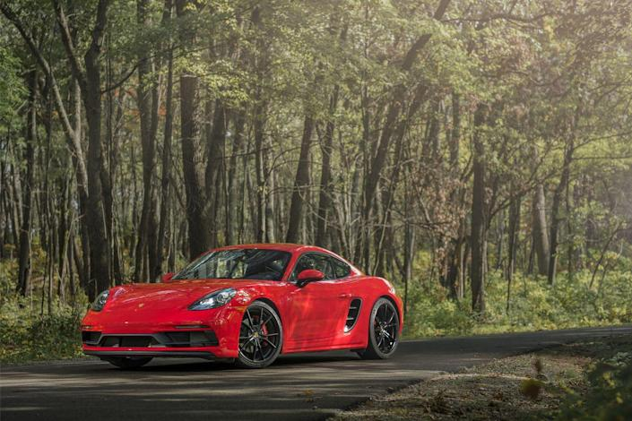 "<p>The Porsche 718 Boxster <a href=""https://www.caranddriver.com/porsche/718-cayman"" rel=""nofollow noopener"" target=""_blank"" data-ylk=""slk:and Cayman"" class=""link rapid-noclick-resp"">and Cayman</a> have made numerous appearances on our 10Best Cars list, so our feelings can't be explained by budding infatuation, yet we still get that first-date buzz every time we drive them.Their power and performance have risen over the years, and these tightly packaged sports cars have seen minimal dimensional spread. <a href=""https://www.caranddriver.com/porsche/718-boxster"" rel=""nofollow noopener"" target=""_blank"" data-ylk=""slk:The current Boxster"" class=""link rapid-noclick-resp"">The current Boxster</a> is 1.4 inches longer than the original and around 160 pounds heavier. Considering the 49 percent increase in base power, that's entirely acceptable.Porsche also has heightened the technology quotient, adding various active dynamic systems. And the 718's cabin would have seemed otherworldly plush to a buyer of the first-gen Boxster. But the fundamental notion of a light, responsive sports car remains unchanged.</p>"