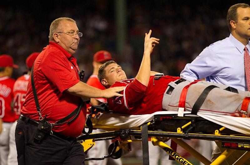 Garrett Richards of the Los Angeles Angels is carried off the field on a stretcher after suffering a leg injury against the Boston Red Sox on August 20, 2014 at Fenway Park in Boston, Massachusetts