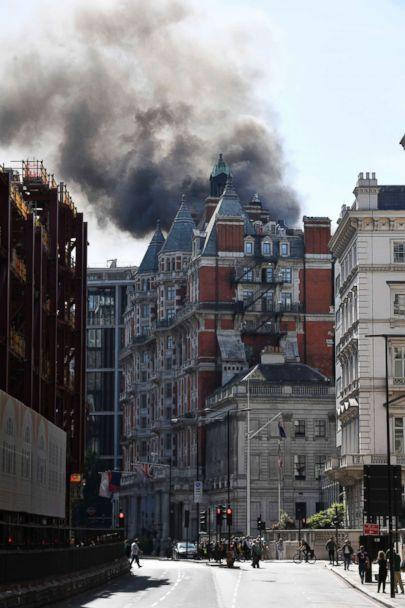 PHOTO: Rauch is emerging from a building in Knightsbridge, central London, when the London Fire Brigade responded on 6 June 2018 to a fire call at this upscale location. (John Stillwell / PA via AP)