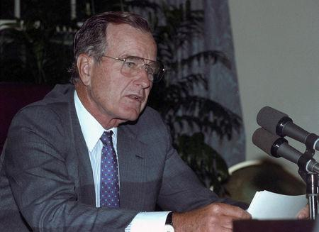 FILE PHOTO: U.S. President George H.W. Bush is seen at the White House after he addressed U.S. troops defending Saudi Arabia August 29, 1990. REUTERS/Gary Cameron/File Photo