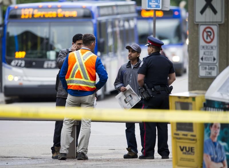 Students are turned away from the scene of a shooting in Edmonton, Canada on Friday, June 15, 2012. Three people are dead and one is in critical condition after a violent armored car robbery early Friday at the University of Alberta campus. (AP Photo/The Canadian Press, Ian Jackson)