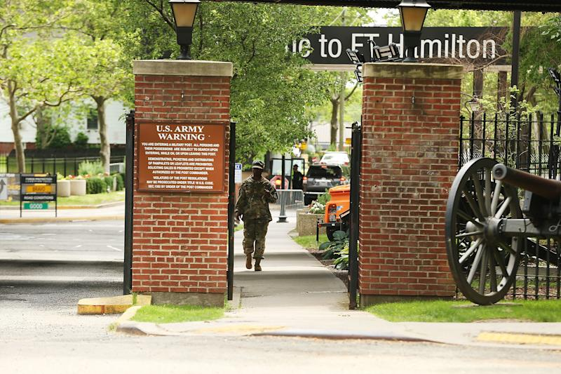 A soldier exits the Fort Hamilton military base in Brooklyn where a pizza delivery man was detained and questioned before being reported to Immigration and Customs Enforcement. (Spencer Platt via Getty Images)