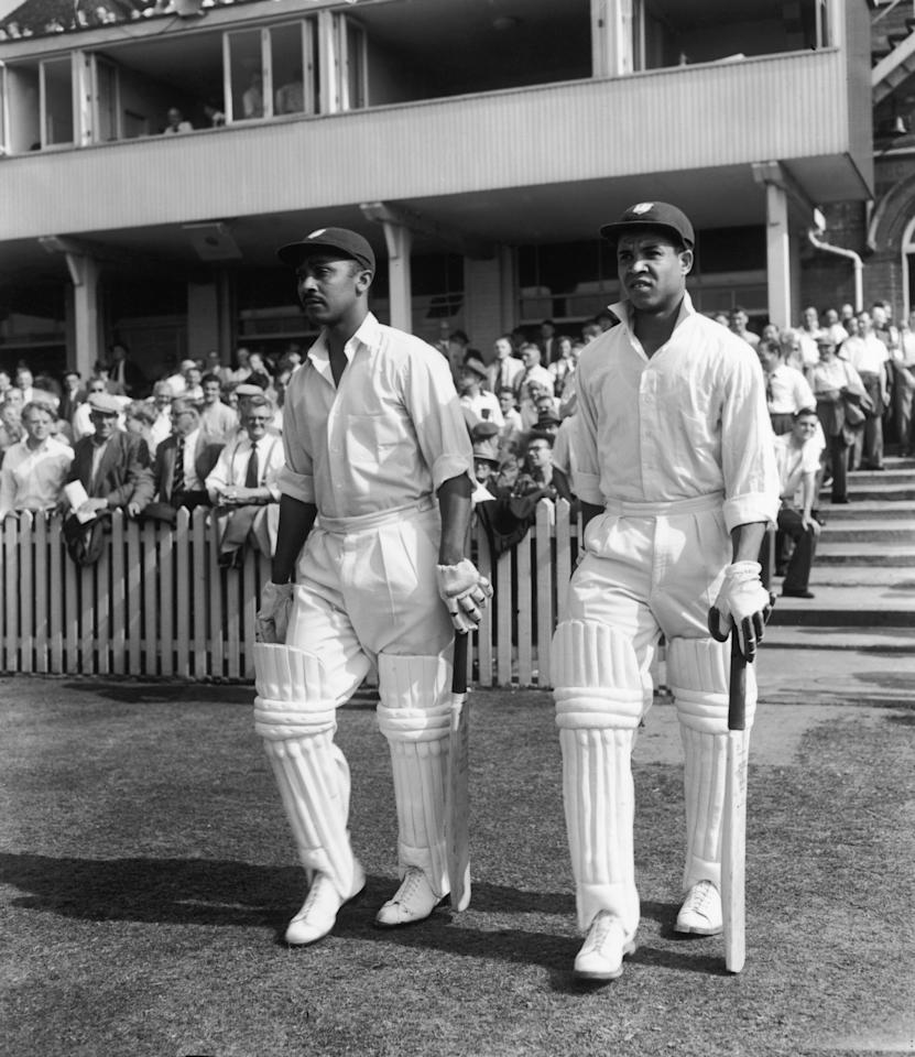 Frank Worrell, left, and Garfield Sobers coming out to bat during the Third England vs West Indies Test at Trent Bridge, Nottingham, July 1957. (Photo by Central Press/Hulton Archive/Getty Images)