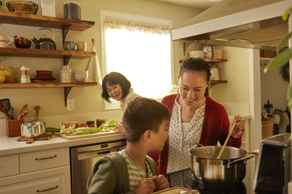 Family cooking one-pot meal together using Canadian Tire cookware