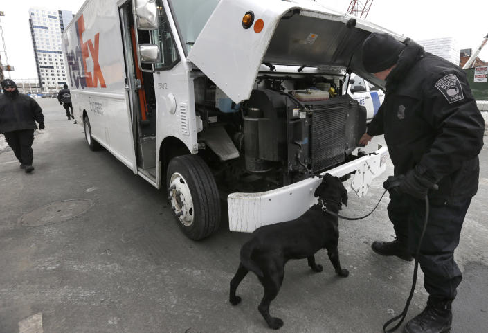 Boston Police Special Operations officers use a bomb-sniffing dog while searching a vehicle on a street near the federal courthouse, in Boston, Tuesday, March 3, 2015. A panel of 12 jurors and six alternates was seated Tuesday after two months of jury selection for the federal death penalty trial of BostonMarathonbombing suspect Dzhokhar Tsarnaev. (AP Photo/Steven Senne)