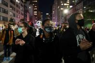 "Demonstrators look on as they take part in the ""People march because the fight continues"" rally the day after Election Day in Manhattan, New York City"