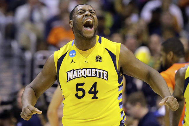 Marquette forward Davante Gardner (54) reacts after scoring during the first half of the East Regional final in the NCAA men's college basketball tournament against Syracuse, Saturday, March 30, 2013, in Washington. (AP Photo/Alex Brandon)