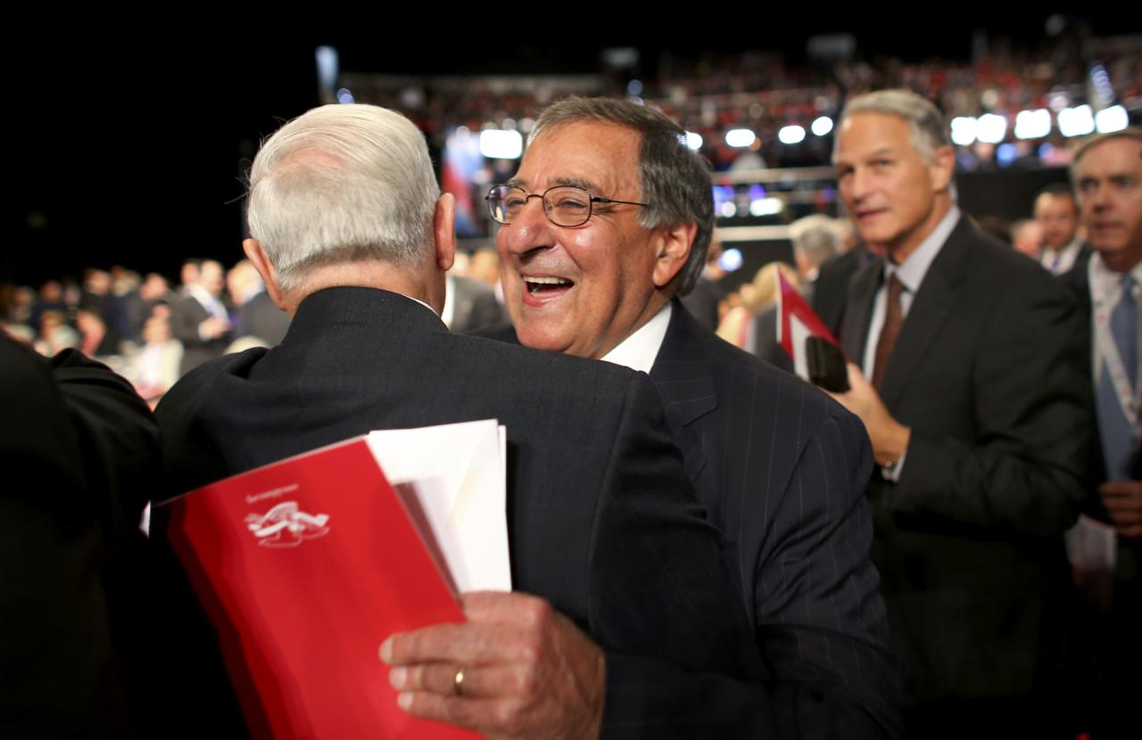 Former Director of the Central Intelligence Agency and former Defense Secretary Leon Panetta hugs another guest in the crowd before the start of the third and final debate between Republican U.S. presidential nominee Donald Trump and Democratic nominee Hillary Clinton at UNLV in Las Vegas, Nevada, U.S., October 19, 2016. REUTERS/Mike Blake