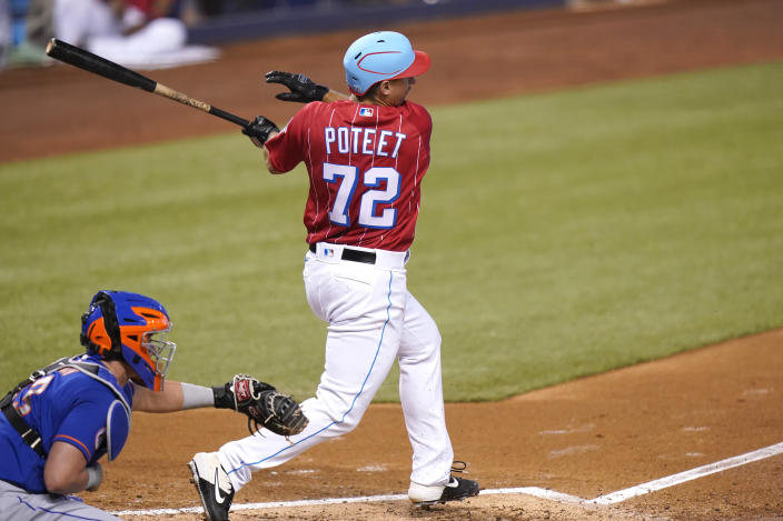 Miami Marlins' Cody Poteet (72) follows through on an RBI-single to score Brian Anderson during the second inning of a baseball game against the New York Mets, Sunday, May 23, 2021, in Miami. (AP Photo/Lynne Sladky)