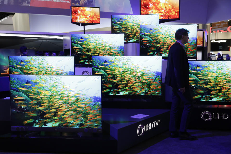 QUHD TVs are on display at the TCL booth during CES International, Thursday, Jan. 5, 2017, in Las Vegas. (AP Photo/John Locher)