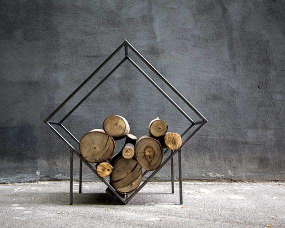 """""""Look for stylish ways to display firewood to instantly create a rustic, log-cabin feel, with or without the fireplace,"""" Johnson says. <a href=""""https://www.etsy.com/listing/517817280/small-firewood-holder-quadrat-storage?ref="""" target=""""_blank"""">Shop it here</a>."""