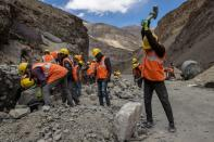 Labourers from the Border Roads Organisation (BRO) work on an under construction highway in the Ladakh region