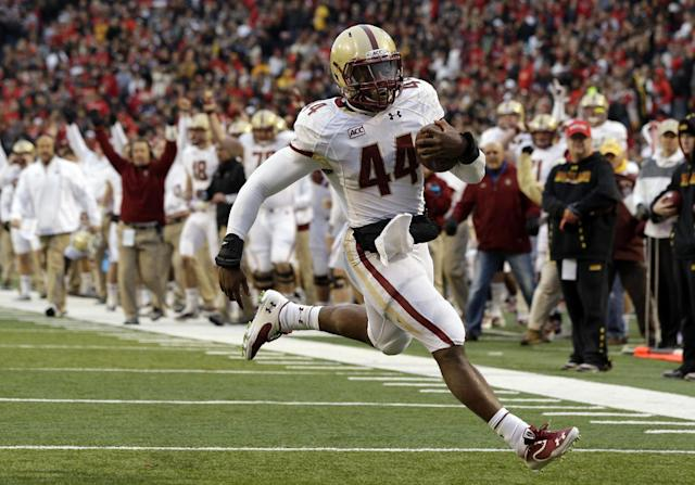 FILem - In this Nov. 23, 2013 file photo, Boston College running back Andre Williams jogs into the end zone for a touchdown in the first half of an NCAA college football game against Maryland in College Park, Md. Williams is a finalist for the Heisman Trophy. (AP Photo/Patrick Semansky, File)