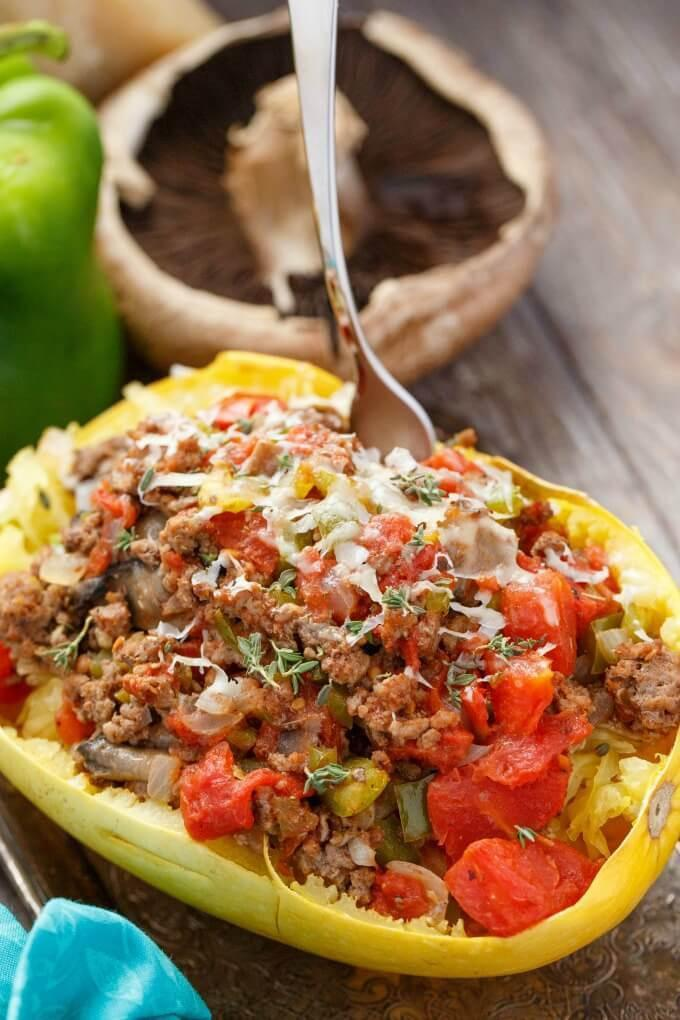 """<div><span>Per ½ spaghetti squash</span>: 249 calories, 6.4 g fat (2 g saturated), 96 mg sodium, 24.2 g carbs, 2.5 g fiber, 4.8 g sugar, 26 g protein</div> Spaghetti squash is a low-cal, satiating replacement for pasta that's a total game-changer: You can't eat 2.5 cups of spaghetti with meat sauce for less than 250 calories and 24 grams of carbs. Traditional spaghetti alone is 552 calories! <strong>Get the recipe from <a rel=""""nofollow noopener"""" href=""""http://thecookiewriter.com/stuffed-spaghetti-squash-with-tomato-and-ground-beef"""" target=""""_blank"""" data-ylk=""""slk:The Cookie Writer"""" class=""""link rapid-noclick-resp"""">The Cookie Writer</a>.</strong>"""