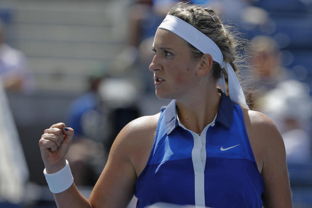 Victoria Azarenka of Belarus celebrates after defeating Christina McHale of the US during the 2014 US Open women's singles match on August 28, 2014 in New York (AFP Photo/Kena Betancur)