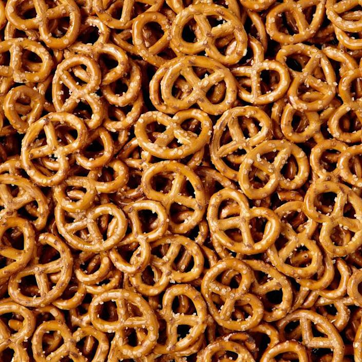 """<p>This one really hurts. """"Pretzels are basically made out of sugar,"""" says Cara Walsh, R.D., of <a href=""""https://medifastcalifornia.com/"""" rel=""""nofollow noopener"""" target=""""_blank"""" data-ylk=""""slk:Medifast Weight Control Centers of California"""" class=""""link rapid-noclick-resp"""">Medifast Weight Control Centers of California</a>. """"The refined-carb product contains no nutrients that are beneficial for health and aren't satisfying, hence why so many people tend to overeat them.""""</p>"""