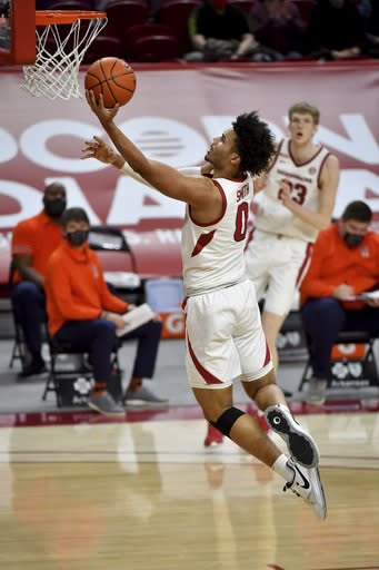 Arkansas forward Justin Smith drives to the basket during the first half of the team's NCAA college basketball game against Auburn on Wednesday, Jan. 20, 2021, in Fayetteville, Ark. (AP Photo/Michael Woods)