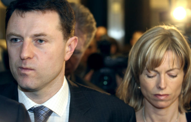 ** FILE ** In an April 10, 2008, file photo Kate McCann, right, and Gerry McCann arrive at the European Parliament in Brussels, Belgium. In a documentary to air in Great Britain on Wednesday April 30, 2008, the parents of missing British girl Madeleine McCann say they're still haunted by their decision to go out for dinner on the night their daughter vanished from a Portuguese resort nearly a year ago. (AP Photo/Geert Vanden Wijngaert/File)