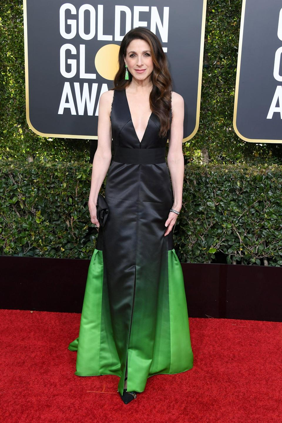 <p>Wearing a Lanvin dress with Olgana Paris pumps, Henri Sillam jewels, and a Chanel clutch.</p>
