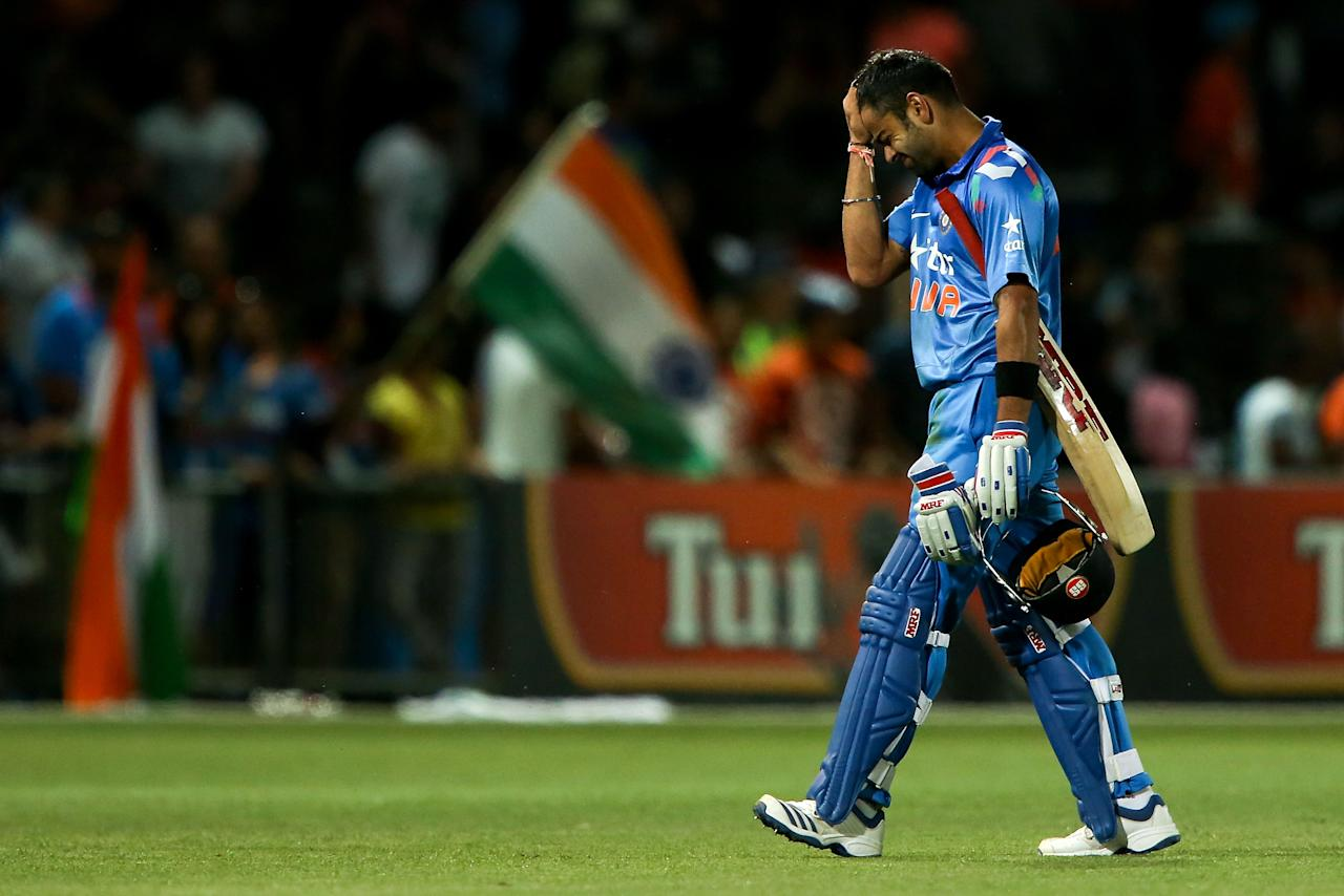 NAPIER, NEW ZEALAND - JANUARY 19:  Virat Kohli of India shows his disappointment after being dismissed during the first One Day International match between New Zealand and India at McLean Park on January 19, 2014 in Napier, New Zealand.  (Photo by Hagen Hopkins/Getty Images)