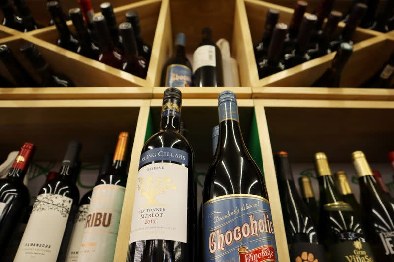 Bottles of South African wine are displayed among others at a supermarket in Beijing