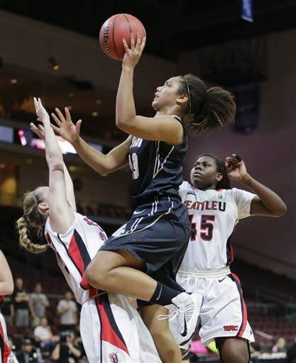 Idaho's Ali Forde (13) shoots against Seattle's Maggie McCarthy as Brenda Adhiambo (45) watches in the first half of their NCAA college basketball game in the Western Athletic Conference tournament championship, Saturday, March 16, 2013, in Las Vegas. (AP Photo/Julie Jacobson)