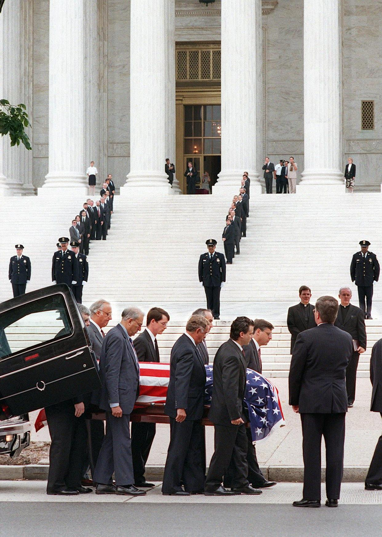 The body of formerJustice William Brennan is carried out of the hearse before beingtaken into the Supreme Court on July 28, 1997, where hethen lay in repose.