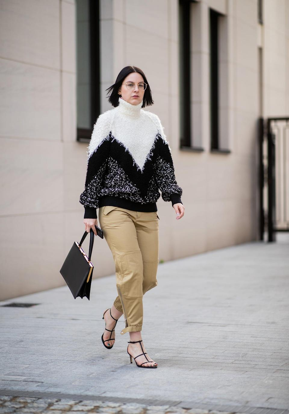 <p>No-fuss styling solution? Just top cargo pants with a slouchy sweater and finish with heels. </p>