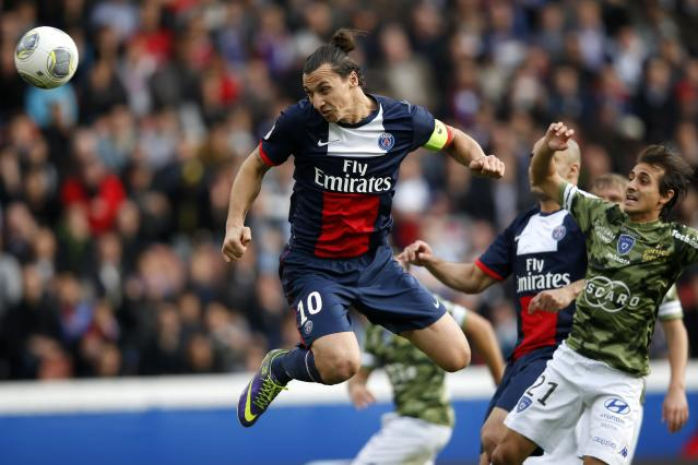 Paris St Germain's Zlatan Ibrahimovic shoots and scores a goal for the team during their French Ligue 1 soccer match against Bastia at the Parc des Princes Stadium in Paris October 19, 2013. REUTERS/Benoit Tessier (FRANCE - Tags: SPORT SOCCER TPX IMAGES OF THE DAY)