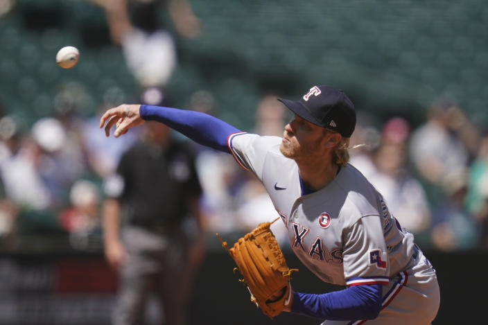 Texas Rangers starting pitcher Mike Foltynewicz throws against the Seattle Mariners in the fourth inning of a baseball game Sunday, July 4, 2021, in Seattle. (AP Photo/Elaine Thompson)