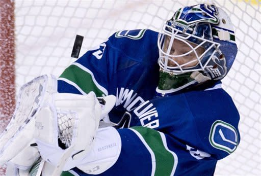 Vancouver Canucks goalie Cory Schneider (35) makes a save during third period NHL hockey action against the Columbus Blue Jackets in Vancouver, British Columbia, Tuesday, March 26, 2013. (AP Photo/The Canadian Press, Jonathan Hayward)