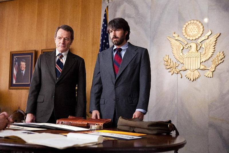 "FILE - This undated publicity film image released by Warner Bros. Pictures shows Bryan Cranston, left, as Jack O'Donnell and Ben Affleck as Tony Mendez in ""Argo,"" a rescue thriller about the 1979 Iranian hostage crisis. ""Argo"" earned a adapted screenplay nomination from the Writers Guild on Friday, Jan. 4, 2013, for outstanding screen writing. (AP Photo/Warner Bros., Claire Folger, File)"
