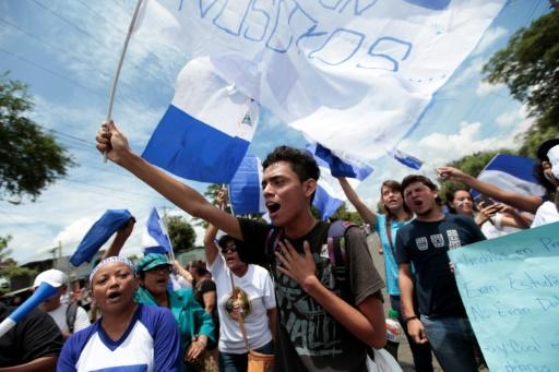 Demonstrators shout anti-government slogans as Nicaragua's President Daniel Ortega meets with the nation's Roman Catholic bishops and opposition leaders May 16, 2018 amid growing unrest
