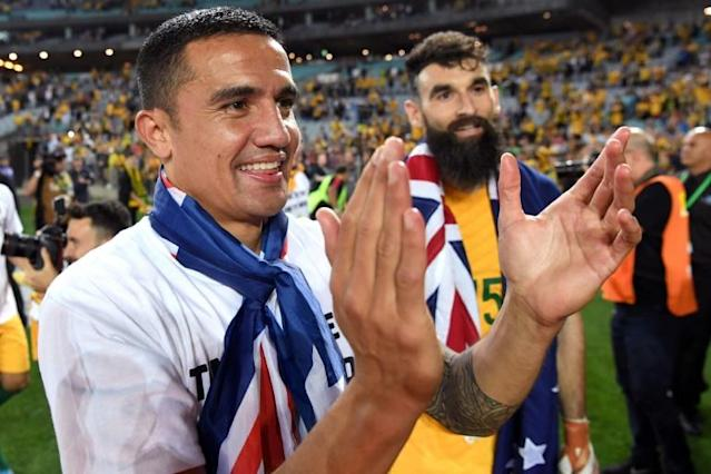 Tim Cahill (left) and Australia captain Mile Jedinak celebrate in Sydney after defeating Honduras 3-1 on aggregate to reach the World Cup finals in Russia